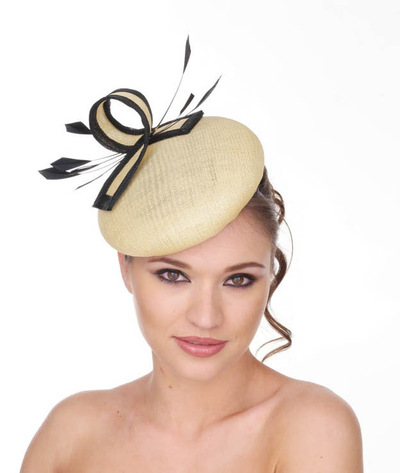 My Little Hat Shop - Yellow button hat decorated with black and yellow curl decoration and shaped black feathers.