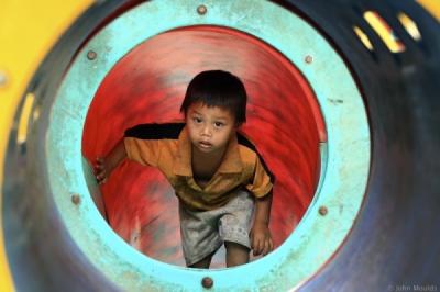 face of vietnam - In Nam Cau School a La Hu boy climbs the slippery slide