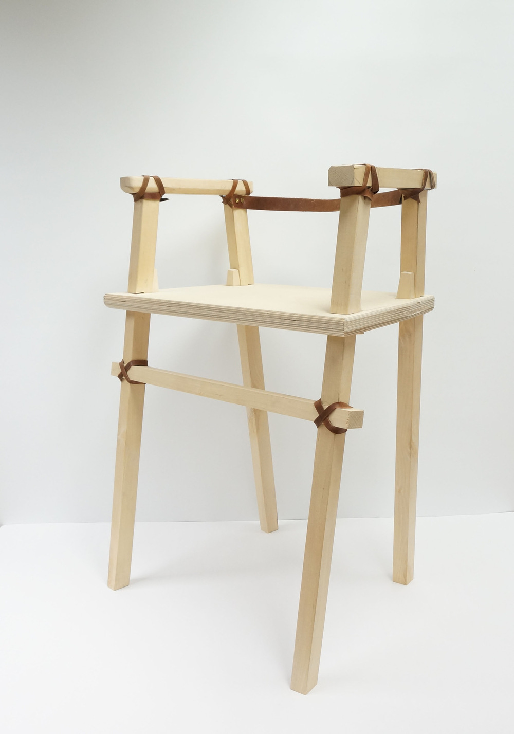 Dackelid Form - The legs go through the seat with a cut out joint and wedges, when the user sits down the weight of the person will lock the construction