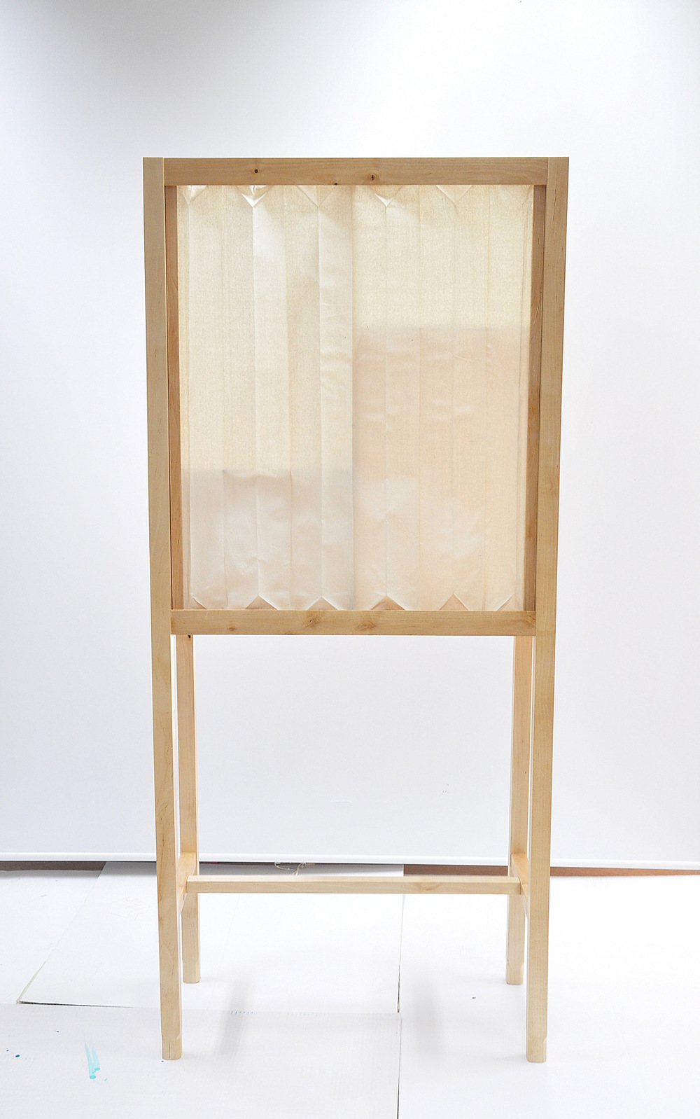 Dackelid Form - The cabinet has doors and sides made of raw silk dipped in a mix of wood glue and water to get the stiffness to make the creases