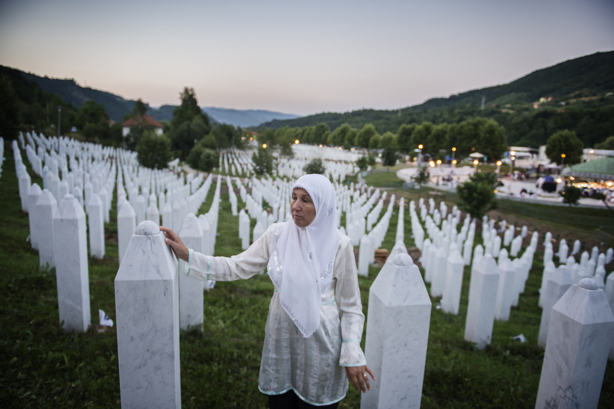 Photographer Anna Tärnhuvud - Hajreta lost her father, brother and husband in 1995. Shes standing at their graves at the Potocari burial site the night before the 20-year memorial day.