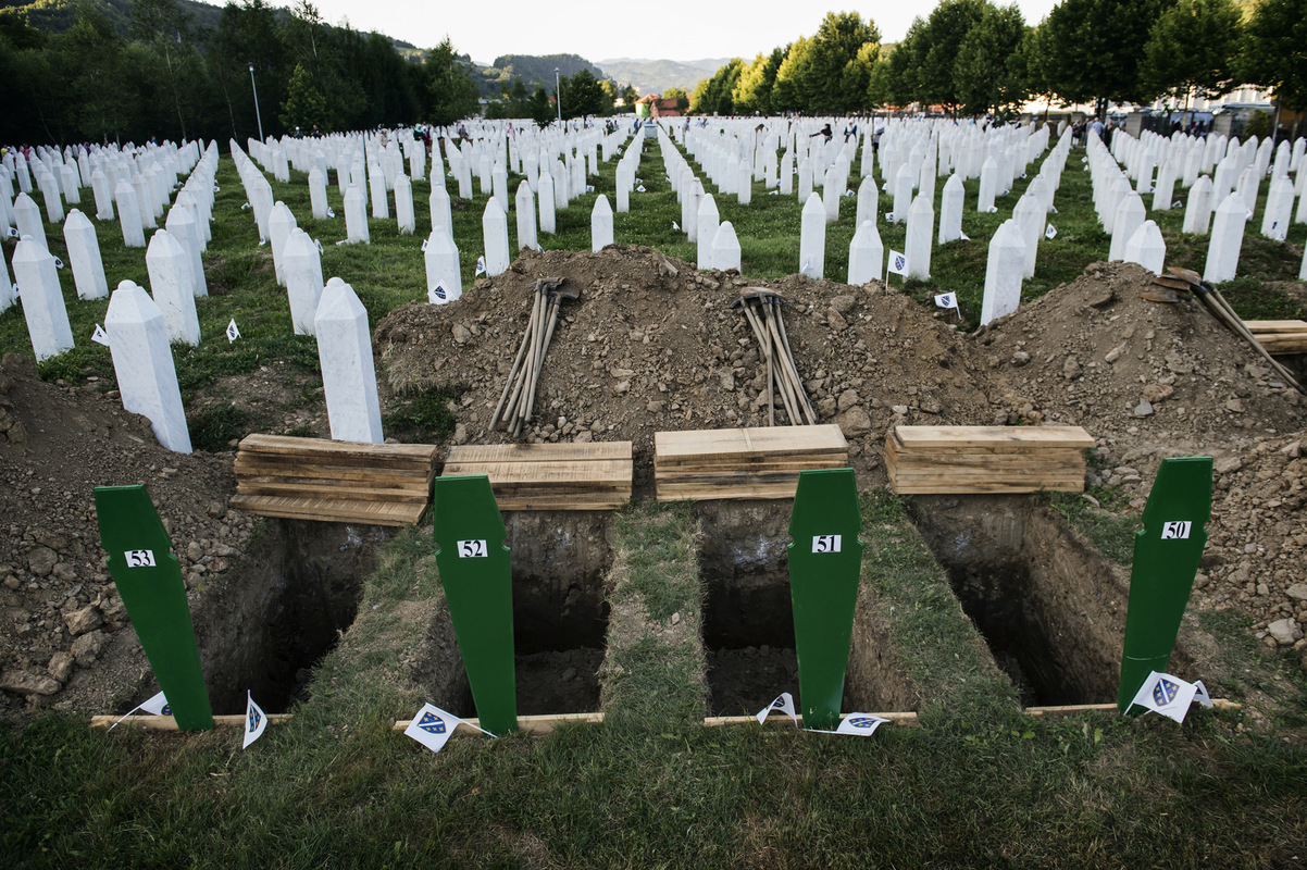 Photographer Anna Tärnhuvud - In these graves a father and his three sons who were killed in July 1995 will be buried.
