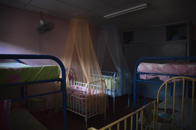 Photographer Anna Tärnhuvud - One of the bedrooms at Casa Alianzas - home for young mothers.