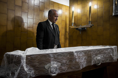 nicolascarvalhoochoa - The driver Darío Leguizamón observes the body of a man prepared for his vigil at the funeral home.