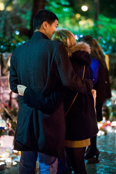 nicolascarvalhoochoa - A young couple visits the memorial created in front of Le Bataclan theatre. The French newspaper Libération gave the name, Génération Bataclan to the victims of the attacks because they were seen as young, festive, open and cosmopolitan. The majority of the 130 dead were between the ages of 21 and 40. [Paris, November 19th, 2015]