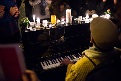 nicolascarvalhoochoa - An Irish pianist plays in front of Le Bataclan theatre, mainly used for music performances. Different musicians visited the site to perform at the memorial and pay tribute to the victims. [Paris, November 21st, 2015]