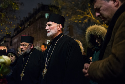 nicolascarvalhoochoa - A group of Russian Orthodox monks pray in a memorial set up at the entrance of Le Bataclan theatre. The Russian Orthodox Church has called on people to learn from the terrorist attacks in Paris and mobilize together to fight the terrorism. [Paris, November 21st, 2015]