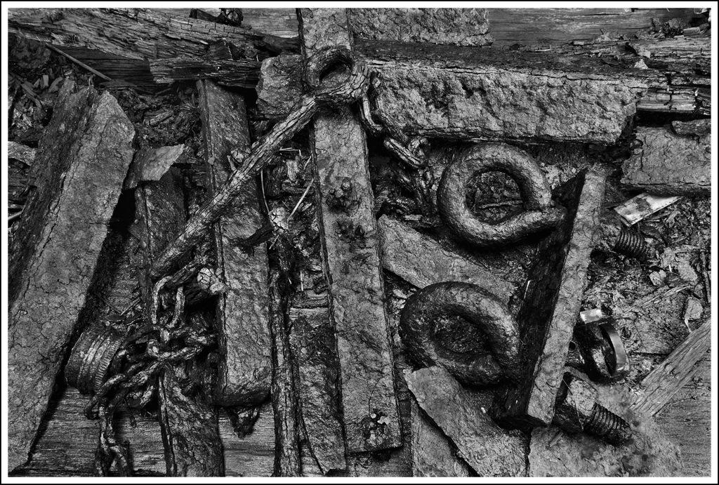 Simon Larson Photography - Rusting metal, abandoned outhouse