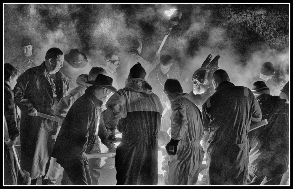 Simon Larson Photography - Guizer Jarl surrounded by Guizers lighting their torches from his fire