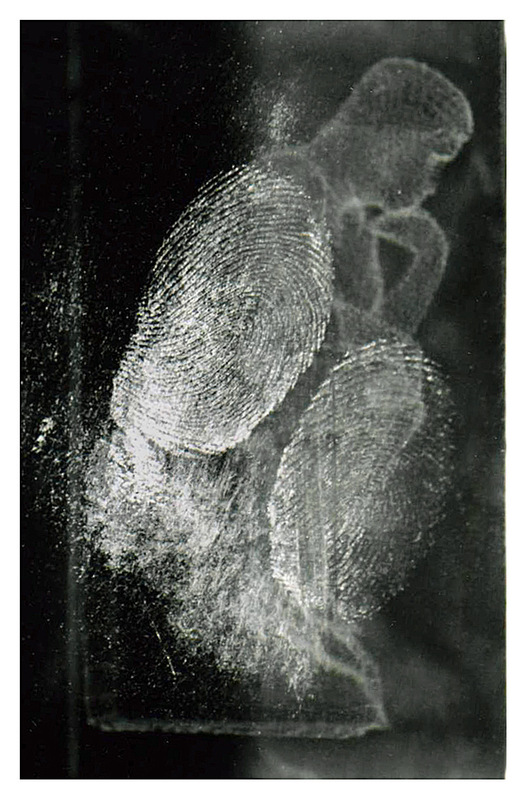 Simon Larson Photography - Forensic Image showing finger prints on glass sculpture