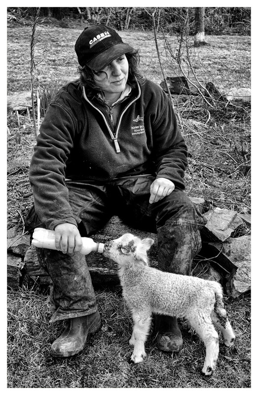 Simon Larson Photography - Crofter Janet feeding rejected lamb