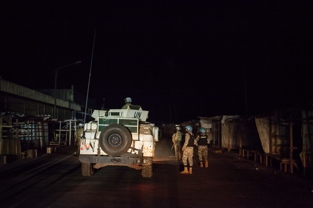 Adrienne Surprenant - Blue helmets from the Portuguese and the Jordanian forces patrolling in the Pk5 market, in Bangui.