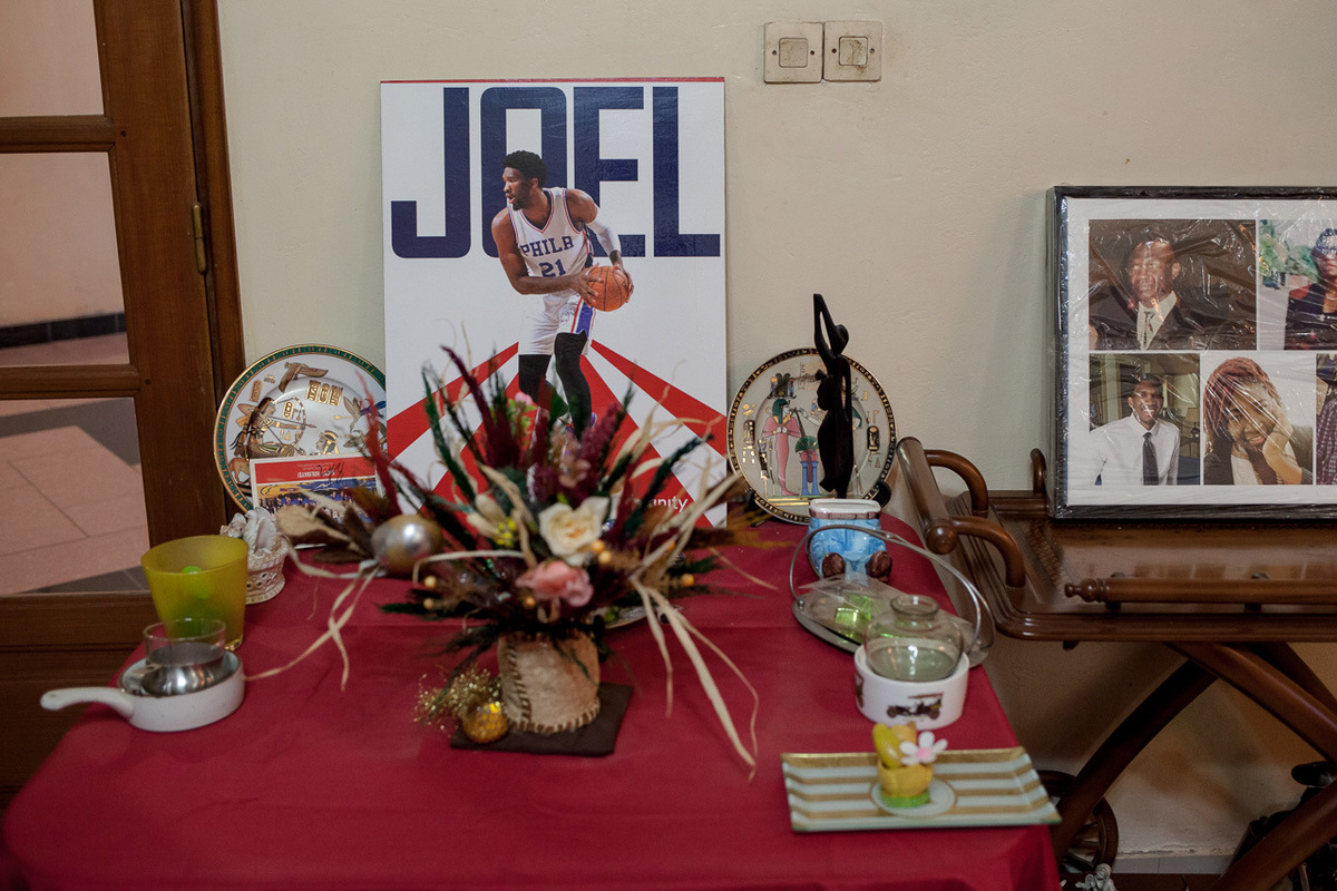 Adrienne Surprenant - In the Embiids house in Damase neighborhood, Yaounde, Cameroon, the parents exhibit a picture of Joel on a table near the entrance.