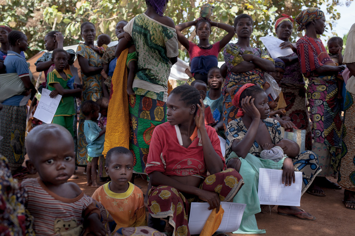 Adrienne Surprenant - Women and children wait to be examined at a health centre near the Catholic mission.