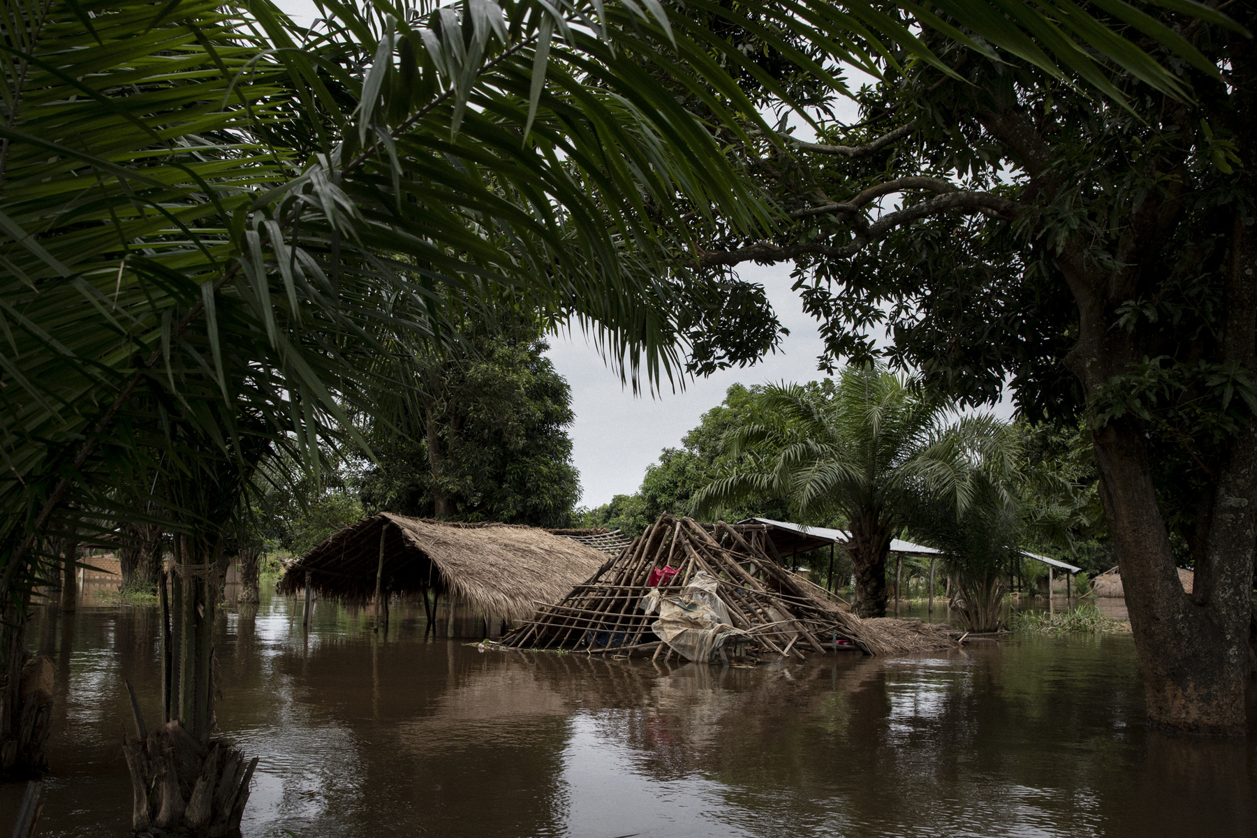 Adrienne Surprenant - On the Île aux Singes, located in the middle of Ubangui River, all the population has fled. Two weeks after the beginning of the floods, the mud-bricks walls of the houses have melted, and many structures fell. November 4, 2019. Bangui, the Central African Republic.