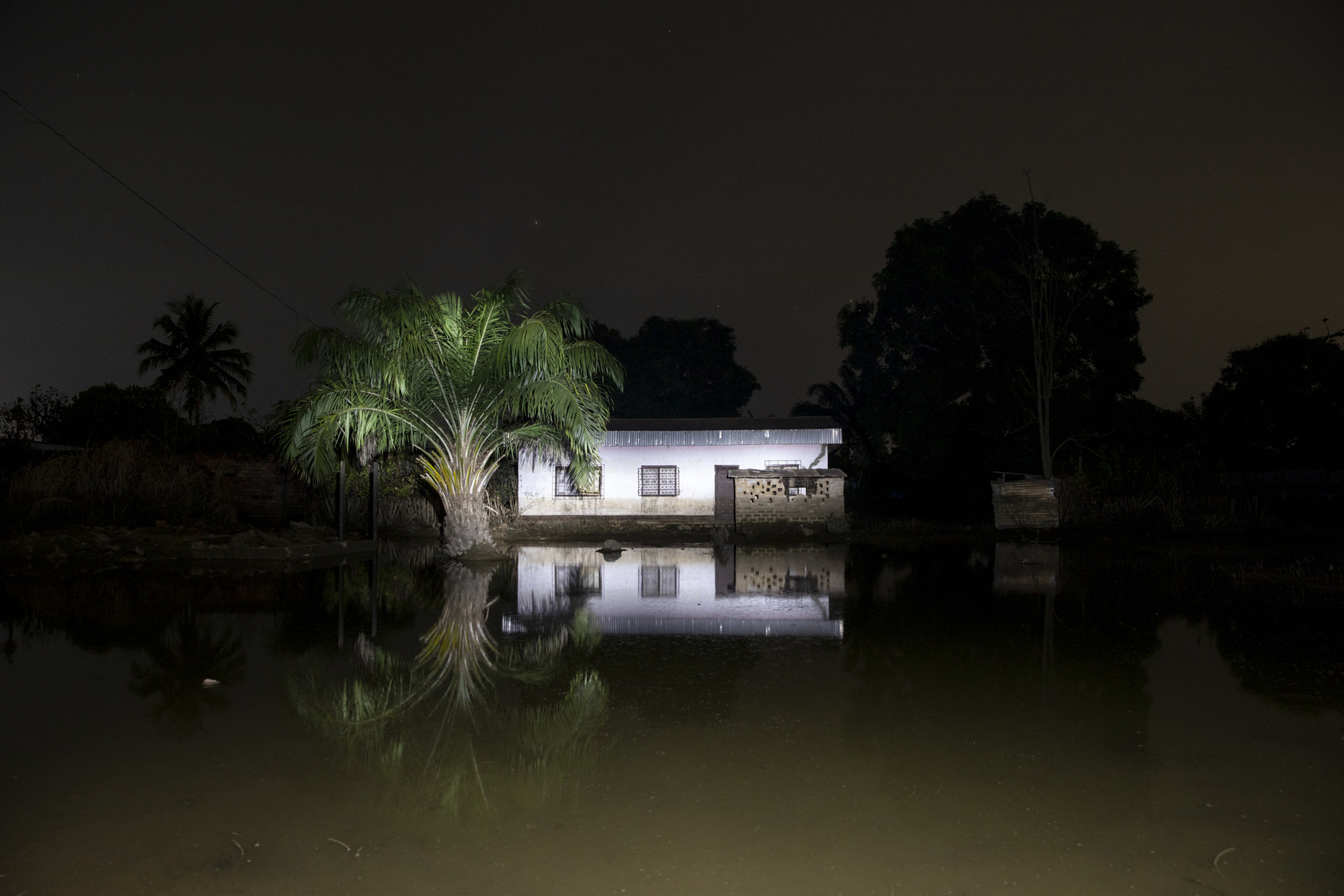 Adrienne Surprenant - A house is seen at night in a flooded neighbourhood of Bangui, capital of the Central African Republic, during a night patrol organised by the neighbourhoods youth.