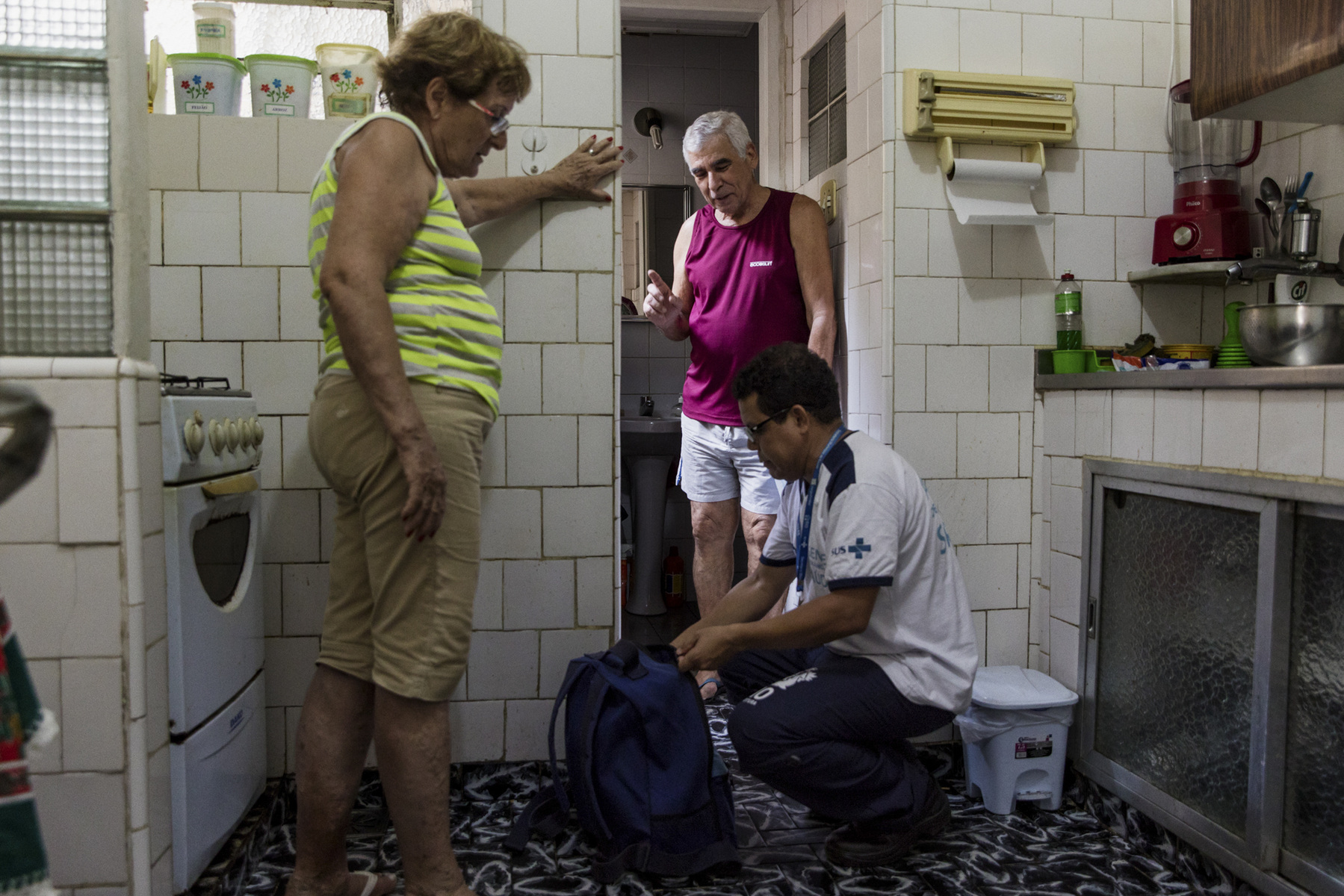 "Adrienne Surprenant - 22/01/2019, Rio de Janeiro, Brazil—Health vigilance agent, Clodoaldo Pesseira Lima, working for Rio de Janeiro's prefecture since 15 years, visits residents of the Grande Tijuca neighborhood to detect mosquito breeding spots. He puts larvicide in dangerous ponds of water. He visits the house of José, who says: ""I was a military and know they offer us a service, when they arrive uniformed. But many people don't open their doors by fear."" Both his wife and him once had dengue. This health vigilance service exists since 1903 in Brazil. Agents have to pass every six months in each house that accepts to receive them."