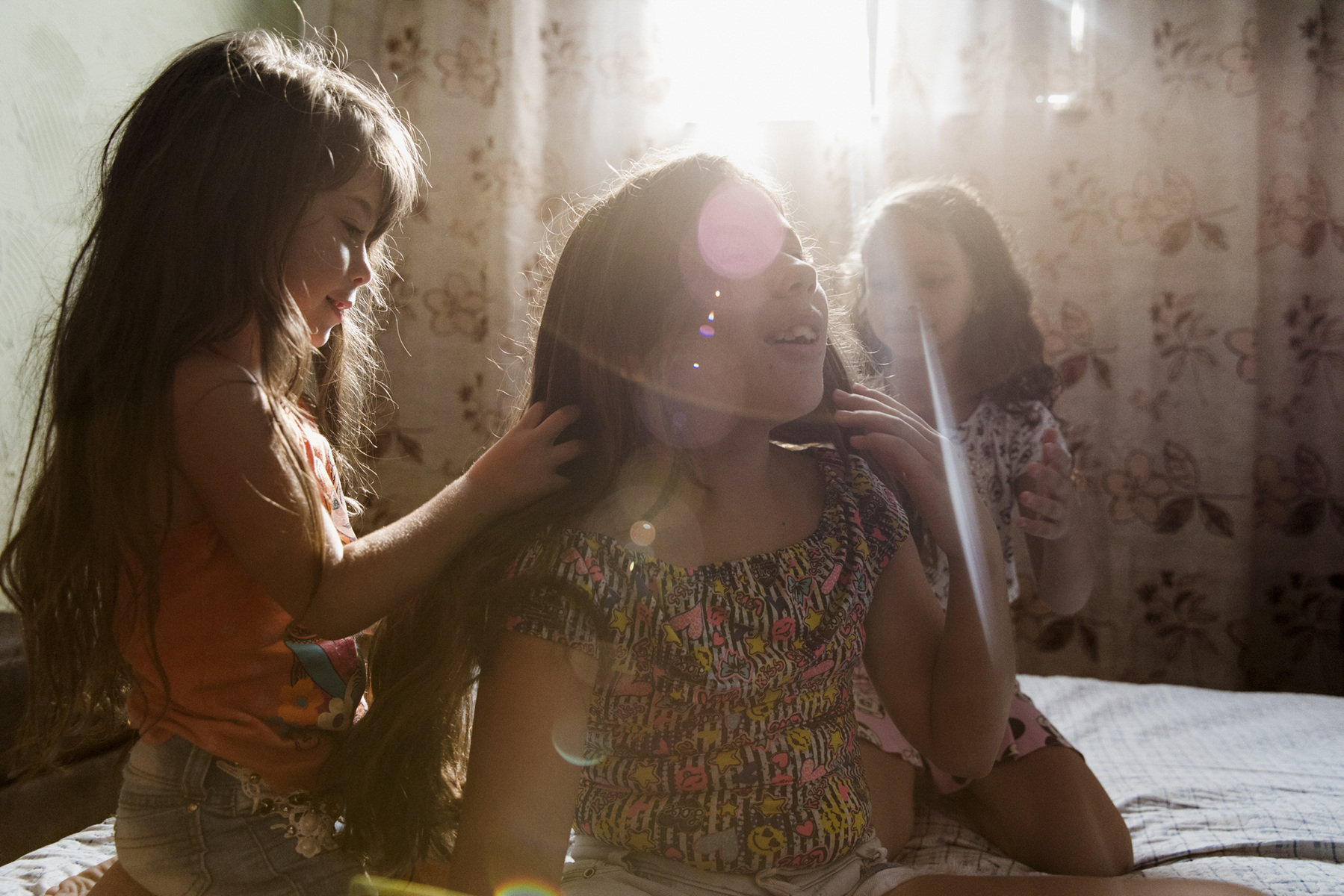 "Adrienne Surprenant - 23/01/2019, Rio de Janeiro, Brazil—Micaelly, 11, Rafaella, 6, and Ana Clara, 7, participate to the TV003 dengue vaccine developed by the National Institute of Allergy and Infectious Diseases (NIAID) at the American Nacional Health Institute (NHI) and the Brazilian governmental research institute Butantan. It's tested in 17 of the 27 Brazilian states over the course of five years. The last phase of this double-blinded test (even doctors don't know which patients received a placebo and which had the vaccine) is conducted in Rio, on children. There are currently five vaccines for dengue under development worldwide, two of them (including the TV003) are potential candidates and at the vaccine. Their mother admits she was very scared until the week after, when none of them had problems. Their grandmother remains furious, saying the parents used their children as ""guinea pigs."""
