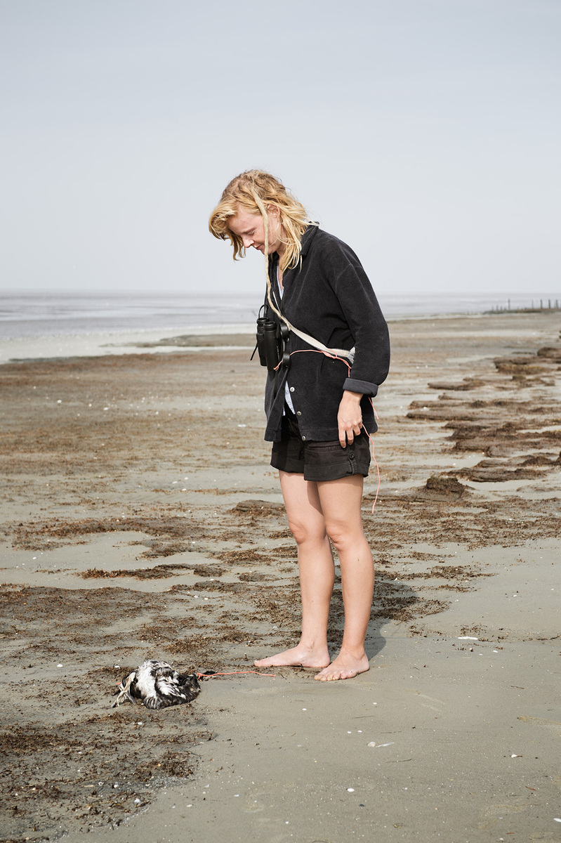 Mareike Timm | Photo Journalist - Every day, Anne de Walmont goes down to the beach to watch birds and see what the sea has washed ashore. This day she discovers a dead bird and writes Eider duck, male, adult, dead a while, bones visible in her notebook after she marked it with a string.