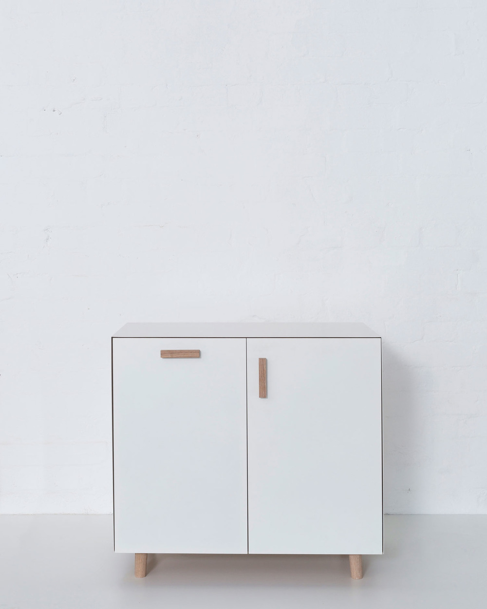 Merrett Houmøller Architects - Cabinet with integrated laundry basket