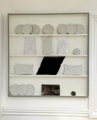 Catalina Renjifo - Mum, 2015 Found shelves, bedsheets, newspaper, coffee, clay, starch, cork, glue, bread, hair