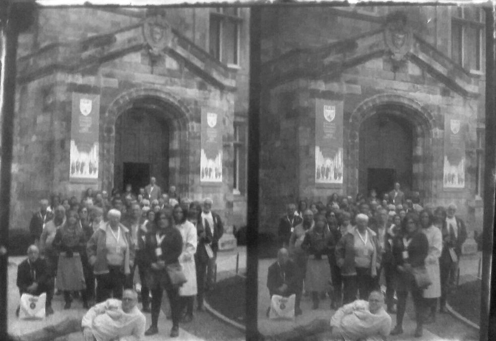 Paper , Shadows and Light. - Delegates of the Stereo photography conference in the court yard of Salvatores college St Andrews. Inverted scan from the Adamsons process Calotype.