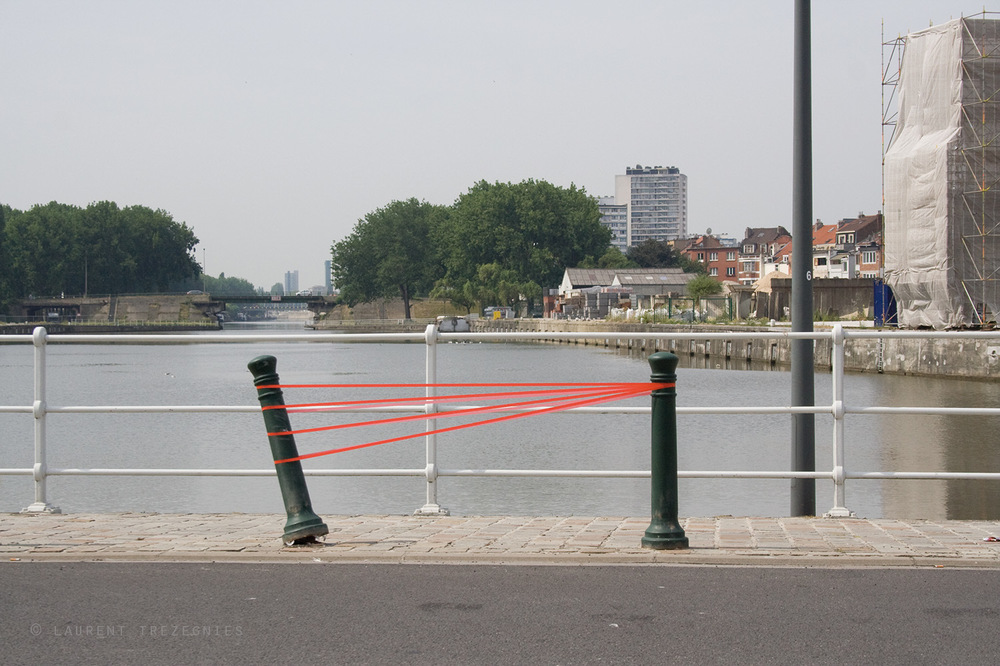 laurenttrezegnies - title urban mutual assitsance intervention on the public space, red sticky tape Bruxelles 2013