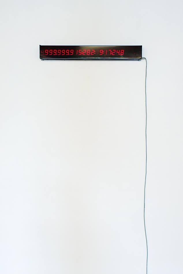 PLACENTIA ARTE - Gianni Motti big crunch clock 1999-5.000.000.000 digital display clock cm. 11 x80 x 6, 1999 [courtesy collezione Lino Baldini] ph. credit Marco Fava