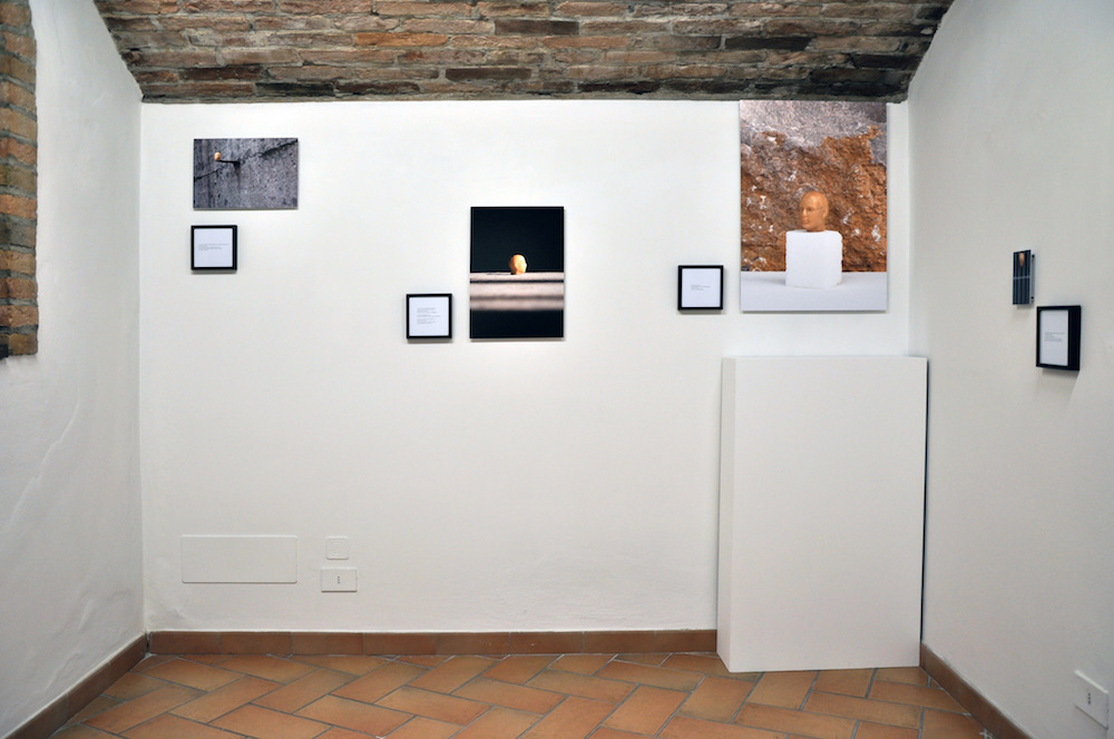 PLACENTIA ARTE - capetto [installation view] Installation- digital photo prints on fiber paper on aluminum [respectively, from left to right] cm. 21 x 36, cm. 45 x 32, cm. 73,5 x 52, cm. 14 x 9 + printed texts cm. 14 x 14 [each], 2016