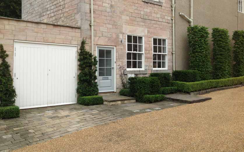 plants by design - East Wing front courtyard. Clipped hornbeam, yew and box hedging.