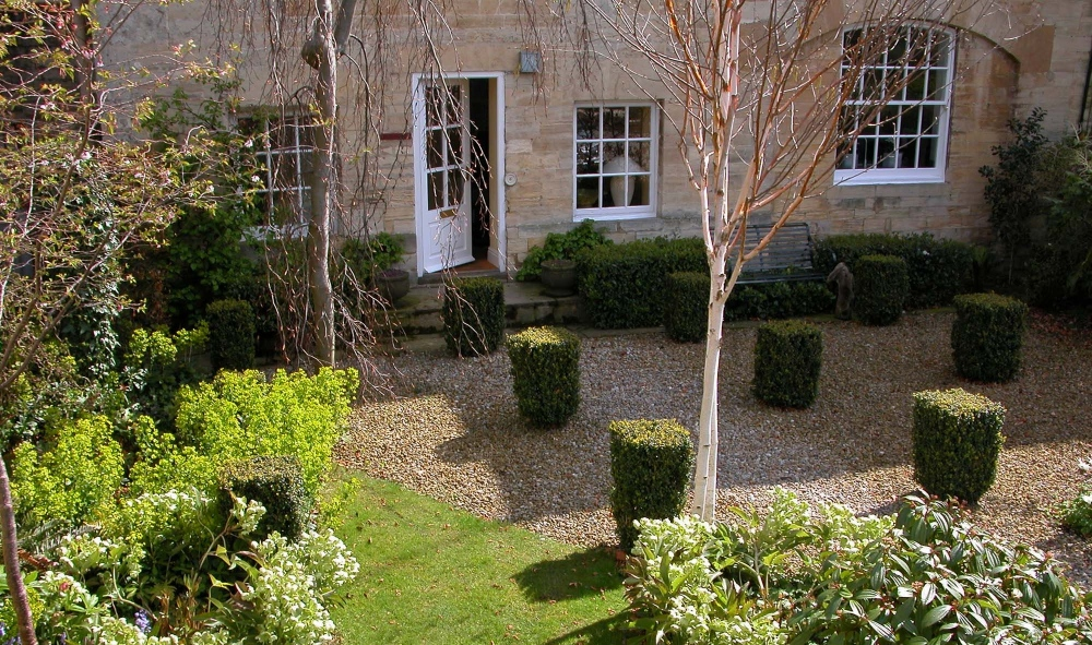 plants by design - The front garden; a grid of clipped box enclosed by tapestry beech hedges