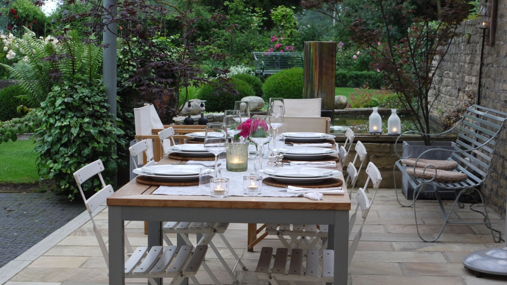 plants by design - A covered canopy provides an effective area for wining and dining