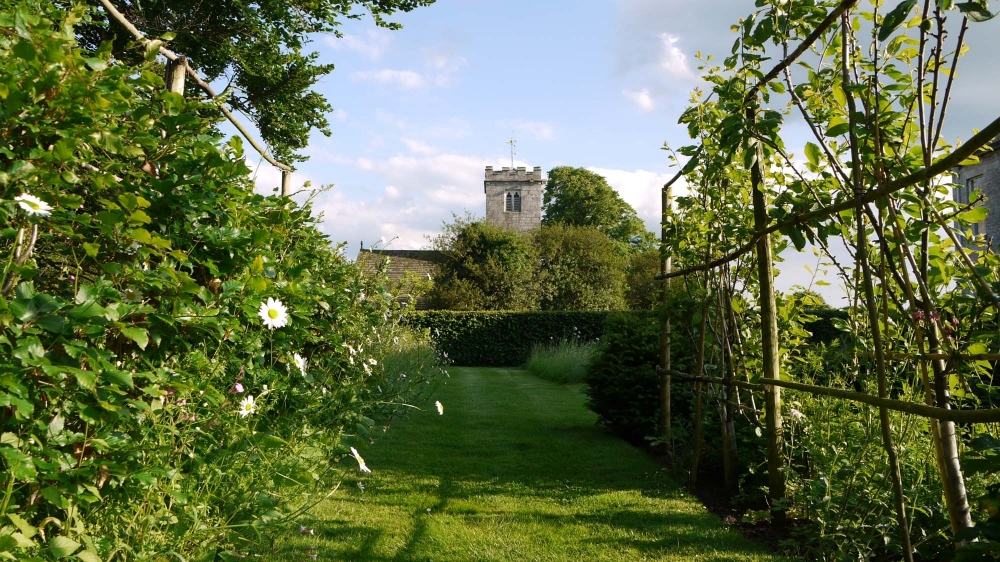 plants by design - A vista to Newton Kyme Church.