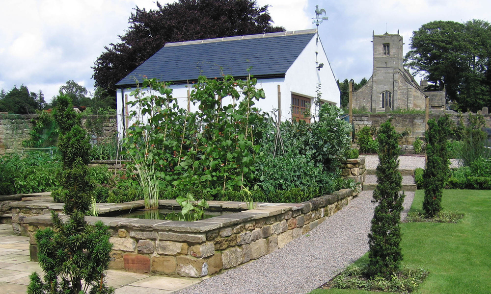 plants by design - the garden includes vegetable and fruit growing areas