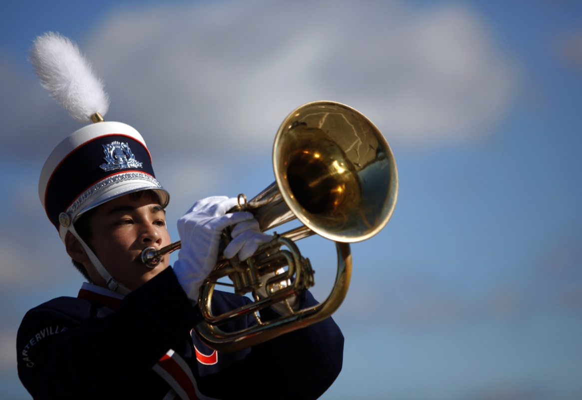 Jennifer Gonzalez | Multimedia Photojournalist - Matthew Wood plays the euphonium during the Music In Motion band competition Saturday.
