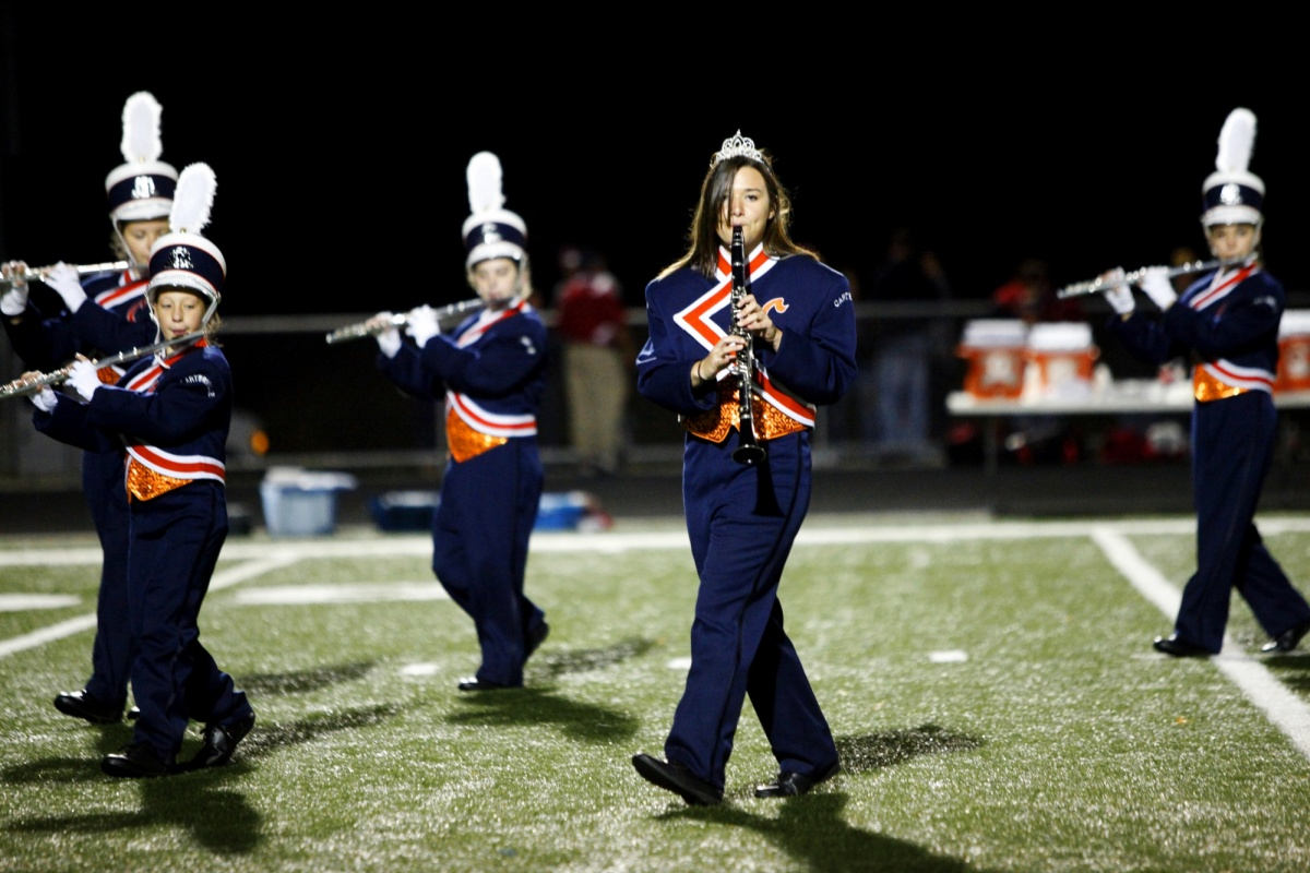 Jennifer Gonzalez | Multimedia Photojournalist - Morgan Dillard, a senior from Carterville, marches during halftime. She replaced her traditional marching band hat and plume with a tiara after being named the 2011 Homecoming Queen.