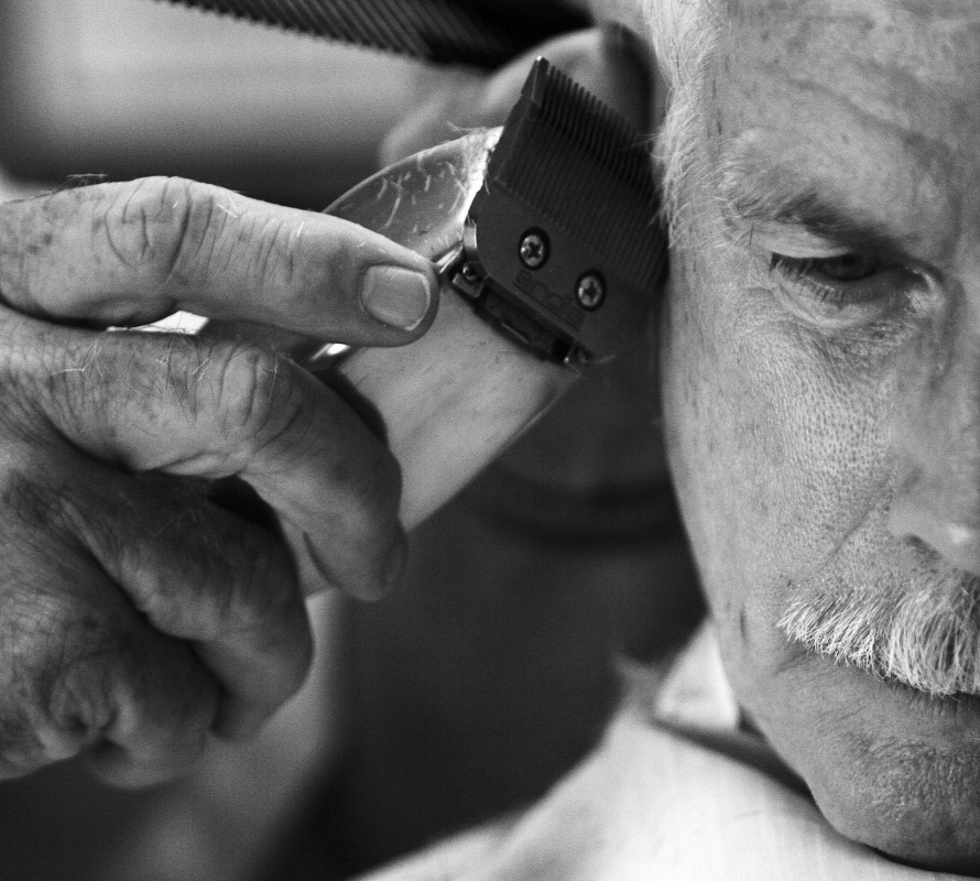 "Jennifer Gonzalez | Multimedia Photojournalist - Ronnie Kempher trims Bob Butz's hair Saturday morning. ""I always said that if I could go 50 years without working, I would be set for life, and to me this isn't working."" Ronnie Kempfer, 68, has owned and operated his barber shop out of Chester, IL for 46 years. ""I started out in December of 1965,"" Kempfer said.In a family friendly environment, Ronnie Kempfer goes on doing what he loves with the people who make him happy. ""I love the people, I love being around them - they're like family."""
