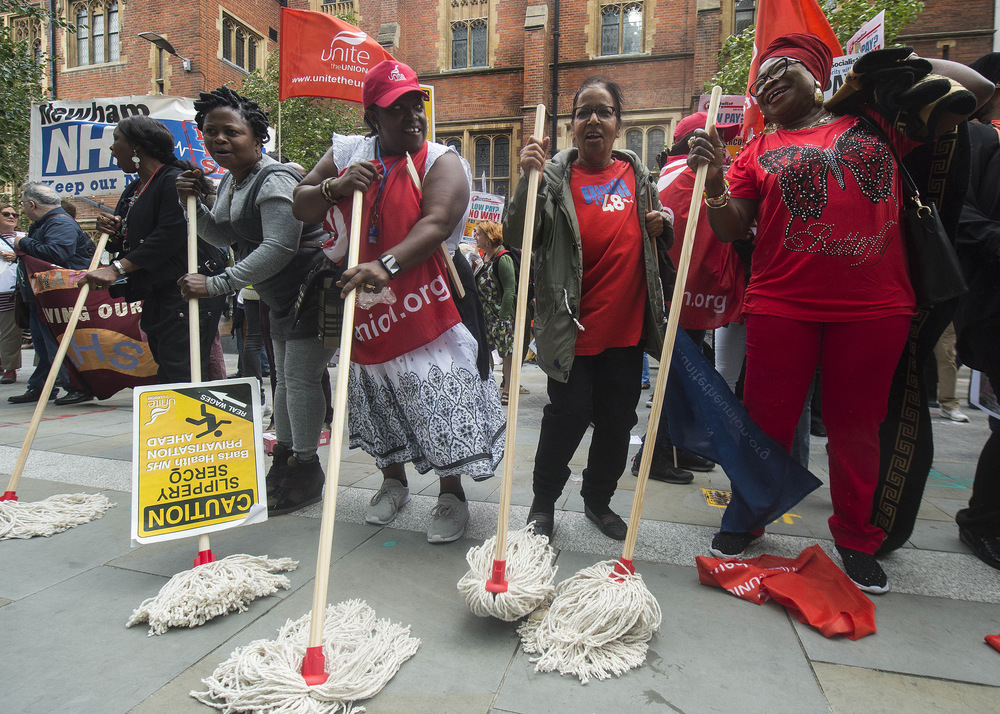 Victoria Jones Press Association Photographer - August 2017  Members of Unite employed by Serco at Barts Health NHS Trust, on strike over pay, protest outside Sercos presentation of financial results at JP Morgan, in London.