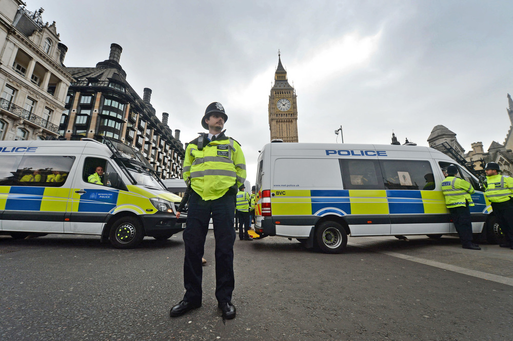 Victoria Jones Press Association Photographer - March 2017  Police block the road outside the Palace of Westminster followingthe Westminster Bridge terror attack.