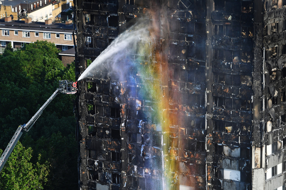 Victoria Jones Press Association Photographer - June 2017  Firefighters continue to tackle the blaze at Grenfell Tower in west London after a fire engulfed the 24-storey tower block.