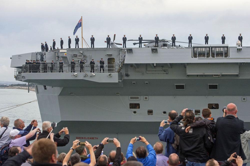 Victoria Jones Press Association Photographer - August 2017  Crowds watch as HMS Queen Elizabeth, the UKs newest aircraft carrier, arrives in Portsmouth.