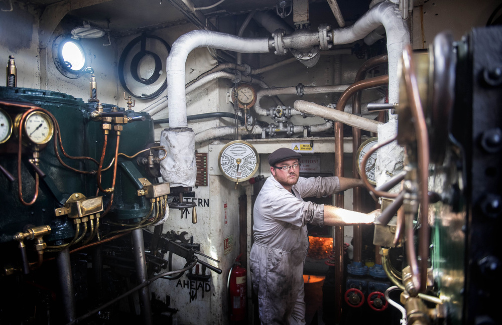 Victoria Jones Press Association Photographer - August 2017  Dan Mothersole, an Engineer Stoker, in the engine room of the ST Portwey, as it celebrates its 90th birthday alongside HMS President in London.