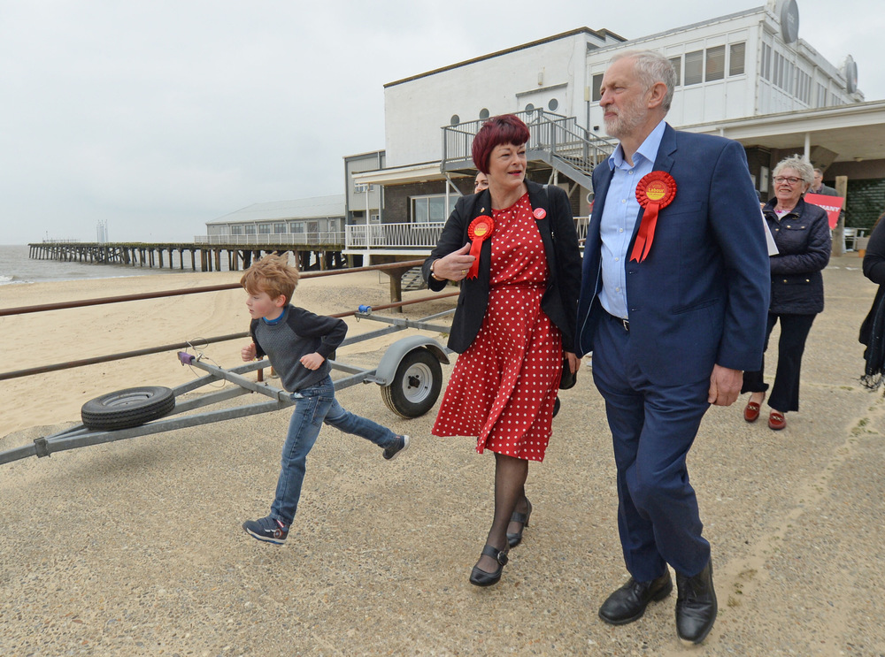 Victoria Jones Press Association Photographer - May 2017  Labour leader Jeremy Corbyn walks by the beach with Labour candidate Sonia Barker at a campaign event in Lowestoft.