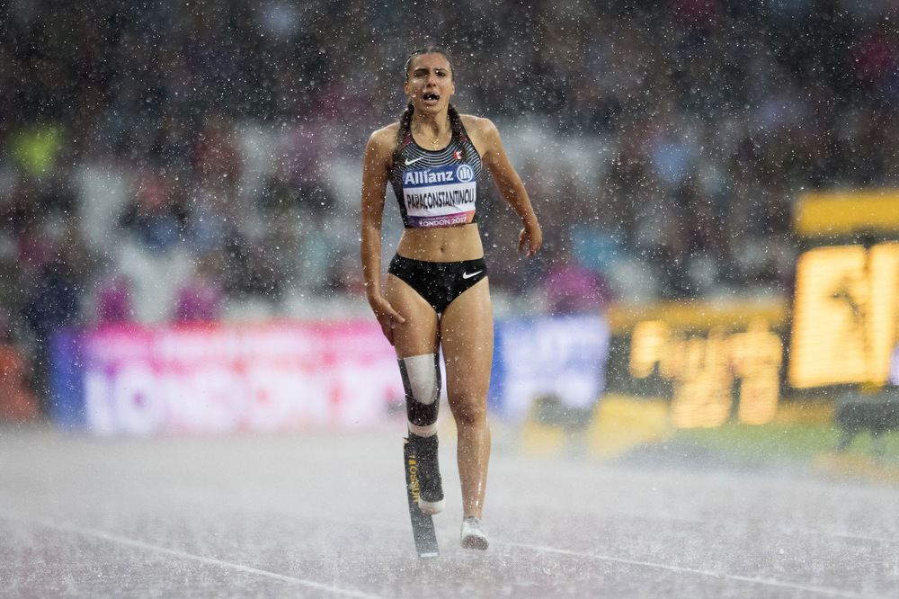 Victoria Jones Press Association Photographer - July 2017  Canadas Marissa Papaconstantinou cries out in pain after falling in heavy rain during the Womens 200m T44 Final during day ten of the 2017 World Para Athletics Championships at London Stadium.