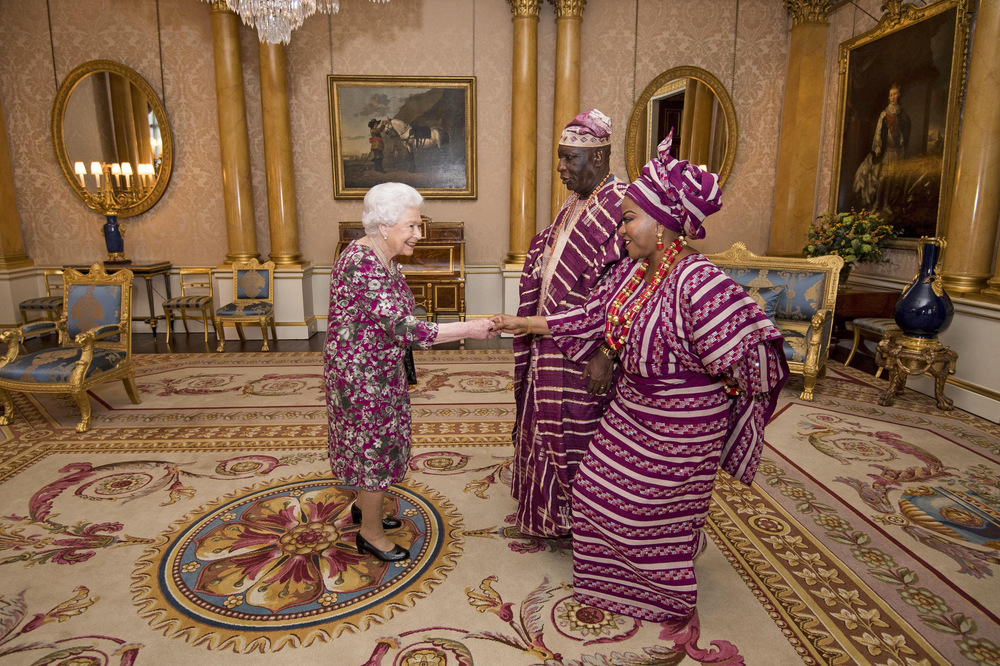 Victoria Jones Press Association Photographer - December 2017  Queen Elizabeth II meets Mr George Adesola Oguntade, the High Commissioner of the Federal Republic of Nigeria, and his wife, Mrs Oguntade, during a private audience at Buckingham Palace in central London.