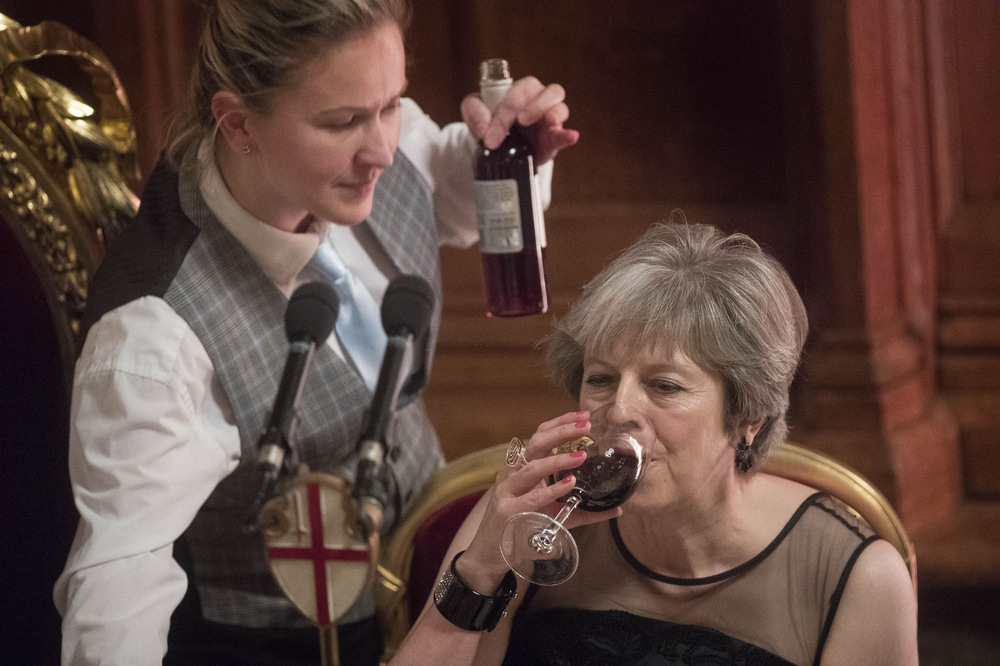 Victoria Jones Press Association Photographer - November 2017  Prime Minister Theresa May drinks wine after she addressed the annual Lord Mayors Banquet at the Guildhall in London as pressure mounts on her leadership.