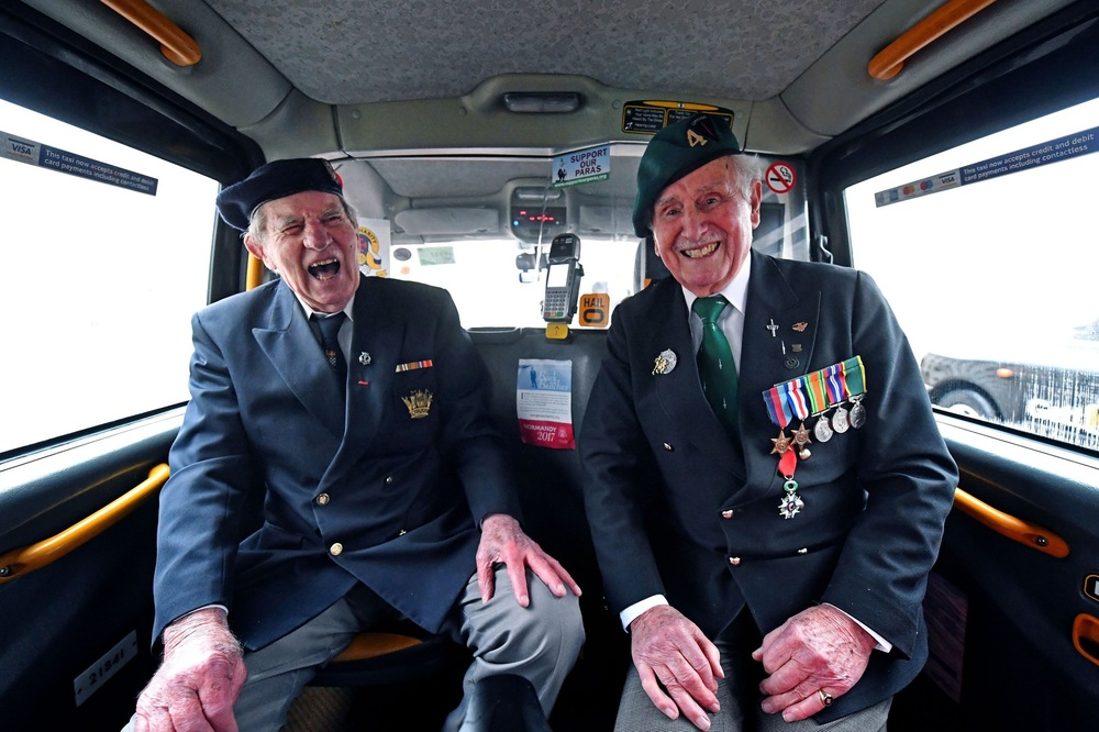 Victoria Jones Press Association Photographer - February 2017  World War II veterans Roy Maxwell and Alf Lonsdale sit in the back of a black cab at Wellington Barracks, London, ahead of their veterans trip to northern France with the Taxi Charity.
