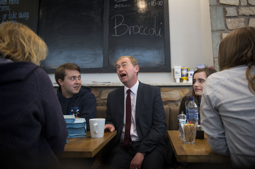 Victoria Jones Press Association Photographer - June 2017  Liberal Democrats leader Tim Farron talks with activists at the Rose and Grants cafe in Glasgow on the General Election campaign trail.