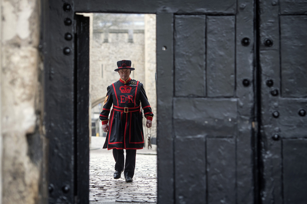 Victoria Jones Press Association Photographer - March 2017  New Chief Yeoman Warder at the Tower of London, Christopher Morton, approaches the entrance gate with the keys for the Tower of London during his first Opening Ceremony.