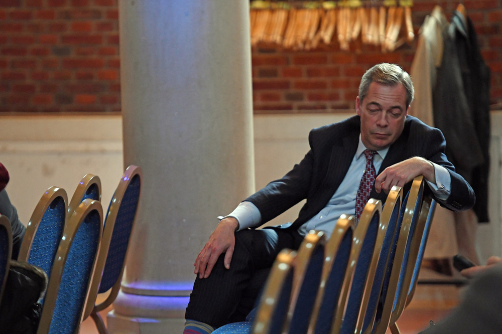 Victoria Jones Press Association Photographer - February 2017  UKIP former leader Nigel Farage rests at the back of a press conference on Brexit in central London.